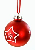 A red Christmas bauble with a white star