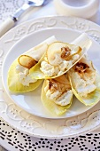 Chicory appetisers with soft cheese, pear and walnut