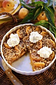 Apricot crumble with cream
