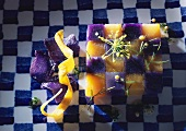 Mosaic of carrots and purple potatoes