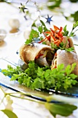 Herring rolls with lemon sauce