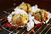 Jacket potatoes on barbecue