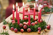 Christmas yew wreath with ornamental apples & 8 red candles
