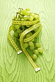 Green grapes with a tape measure