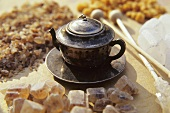 Tea infuser in shape of teapot with sugar crystals