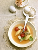 Clear tomato soup with cheese dumplings