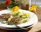 Green spelt burgers with braised cucumber