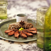 Steamed duck breast with soba noodles & spicy wasabi sauce