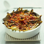 Fennel and tomato gratin with olives and orange zest