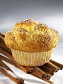 Muffin sprinkled with sugar and cinnamon