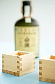 Square sake cups and a bottle of sake