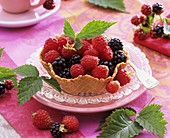 Fresh raspberries and blackberries in waffle bowl