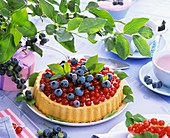 Summery redcurrant and blueberry flan