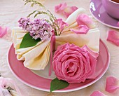 Place-setting decorated with rose and lilac
