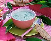 Ramsons (wild garlic) soup in pink bowl