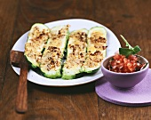 Courgette with cheese crust and tomato and olive salsa
