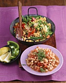 Beans with tomatoes, vegetable paella with yellow lentils
