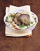 Pea and fennel bake with beef medallions