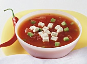Tomato and pepper soup with sheep's cheese