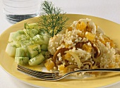 Pan-cooked bulgur wheat dish with cucumber and melon salad