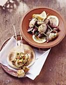 Tuna kebabs and stuffed squid