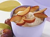 Frozen soft cheese dessert with vanilla and plums
