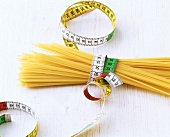 Picture symbolising pasta diet (spaghetti with tape measure)