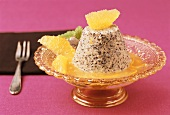Poppy seed flummery with orange sauce