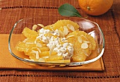 Dish of sliced oranges with almonds