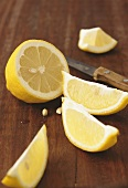 A lemon, halved and in wedges
