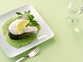 Cod cutlet with parsley sauce