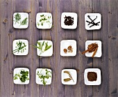 An assortment of herbs and spices in small bowls