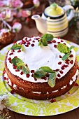 Cake with yoghurt filling and pomegranate seeds