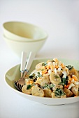 Potato salad with boiled egg and parsley