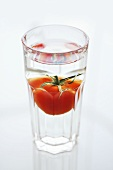 Tomato in a glass of water