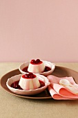 Vanilla blancmanges with raspberry sauce