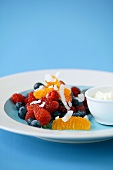 Fruit salad with berries and orange segments