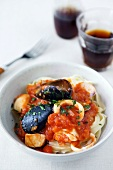 Fettuccine with seafood and tomato sauce