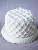 Small white cake with lattice decoration
