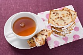 Slices of fruit loaf and a cup of tea