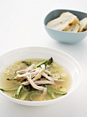 Chicken soup with leeks and asparagus, white bread