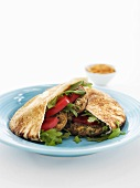 Pita bread filled with lentil burgers and salad