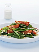Bean and tomato salad with pine nuts