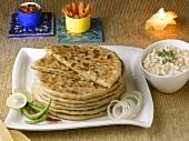 Paratha (stuffed potato bread, India) with boondi raita