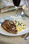 Grilled veal steak with beans
