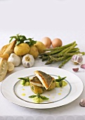 Fried sea bass on potatoes with green asparagus puree
