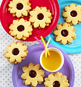 Flower-shaped jam biscuits and orange juice