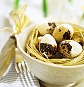 Hard-boiled quails' eggs in ceramic bowl