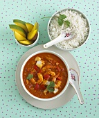 Fish curry with mango and rice