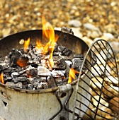 Burning charcoal in rusty barbecue